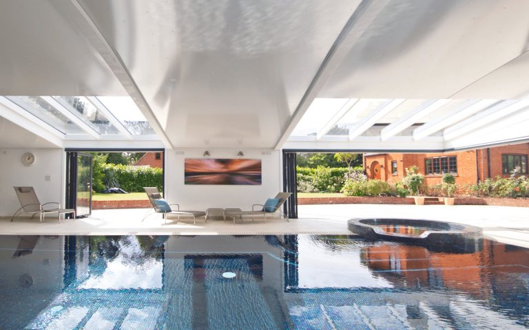 Modern home pool berkshire bifold doors